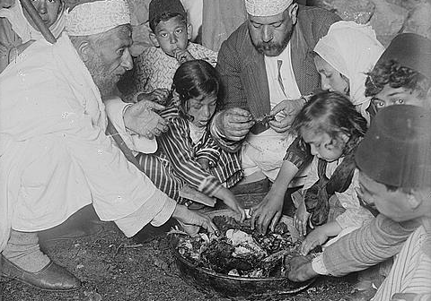Samaritan family sharing Passover sacrifice, ca. 1900-1920, Matson Collection, edited photo from Library of Congress